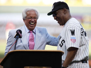 Marty Brennaman hams it up with Bill Cosby. (Getty)