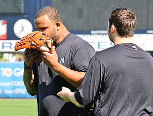 CC Sabathia smells the glove. (AP)