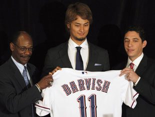 Darvish received a different type of shirt later in the day. (AP)