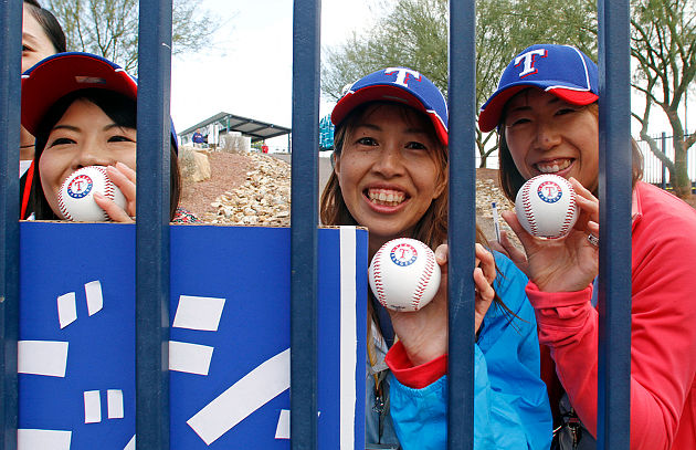 No matter how devoted, fans couldn't get too close to Darvish. (AP)