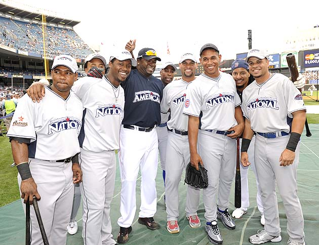 Dominicans! Soriano (dead center) and Marmol (second from right) celebrate at the 2008 All-Star Game. (Getty)