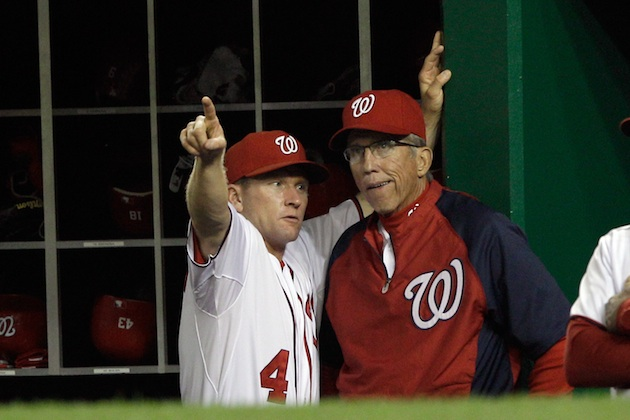 Rick Eckstein showing Davey Johnson where the Nats need to hit the ball. (Getty Images)