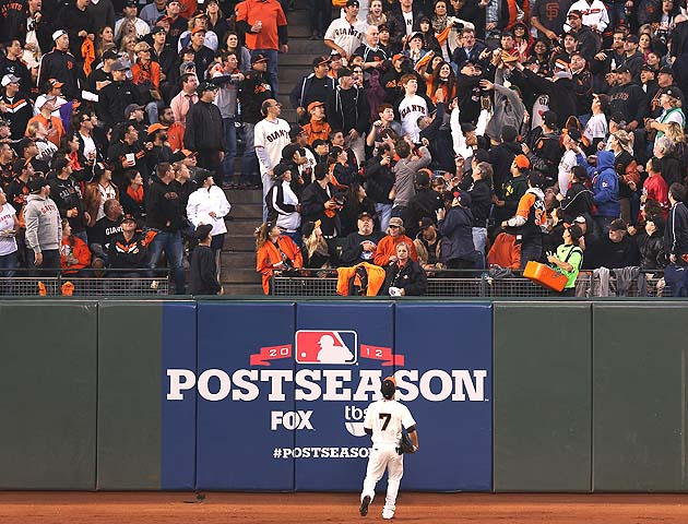 Gregor Blanco watches Carlos Beltran's home run land in the bleachers Sunday night. (Getty)