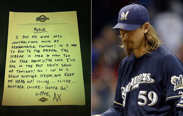 John Axford left this note for the media on Friday night. (@MikeVassallo13/AP)