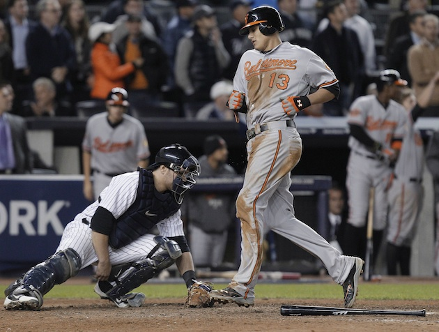 Manny Machado plates the go-ahead run in the 13th inning on Thursday night. (AP)