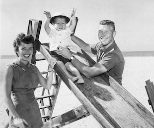 Mantle with his wife 22-month-old Mickey Jr. in 1955. (AP)