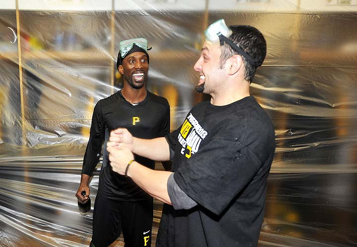 Andrew McCutchen (left) says the ball that hit him Monday regrets it. (Getty)