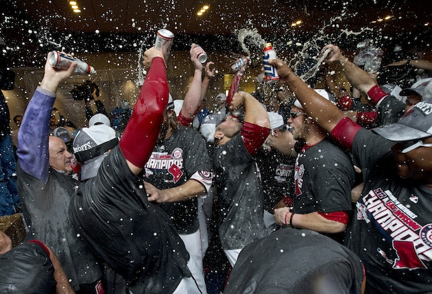 Harper (center, right) celebrates without a beer in his hand. (AP)