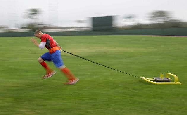 Hunter Pence hauls something heavy around Phillies camp. (AP)