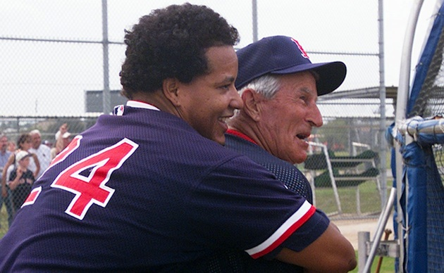 Manny Ramirez hugs Pesky in spring training 2002. (AP)