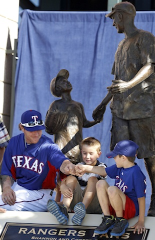 Josh Hamilton visits with Cooper Stone and a friend. (AP)