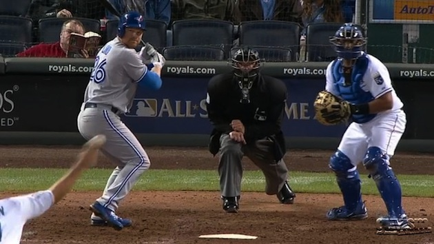 The man in the red shirt has better things to do. (Guyism/MLB.TV)