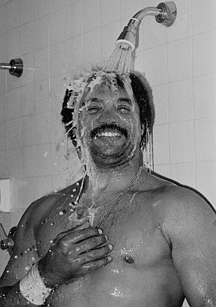 Reggie Jackson washes the champagne off himself following the '78 Series. (AP)