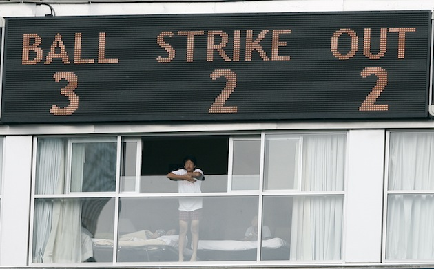 A fan watches from the Renaissance Hotel at Rogers Centre. (Getty Images)
