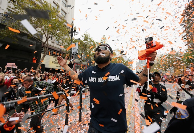 Romo wore a thought-provoking t-shirt at the World Series parade last October. (Getty)