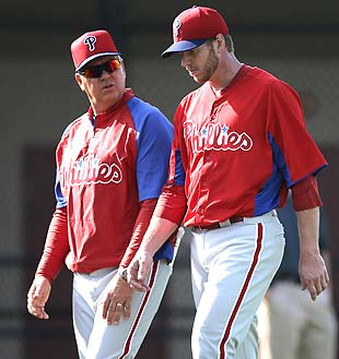 Pitching coach Rich Dubee asks Halladay 'sup?' (AP)