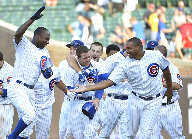 Alfonso Soriano (left) and Carlos Marmol frolic and shake hands during happier times. (Getty)