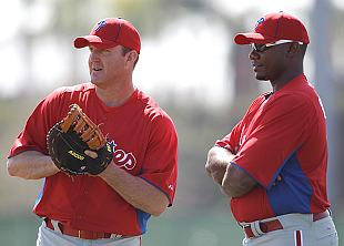 Jim Thome and his mitt are ready to field stuff as Ryan Howard looks on. (AP)