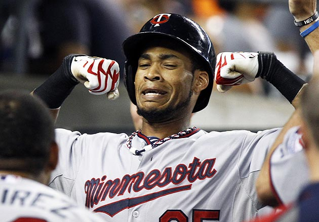 Pedro Florimon of the Twins faux flexes after hitting his eighth home run. (Getty)