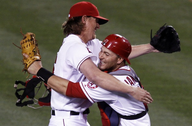 Jered Weaver hugs catcher Chris Iannetta after the final out. (AP)