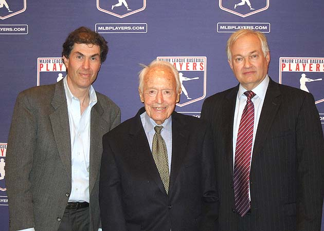 Miller stands with current MLBPA chief Michael Weiner (left) and Miller's successor, Don Fehr, in 2012.