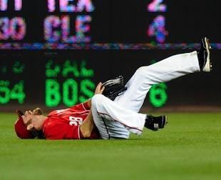 Jayson Werth writhes in pain after breaking his wrist on Sunday night. (Getty Images)
