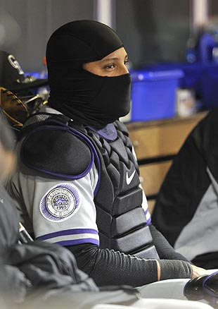 Were S.W.A.T. team ninja turtles really necessary? Oh, that's just Yorvit Torrealba of the Rockies dressed for the cold. (AP)