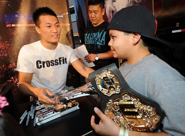Chan Sung Jung talks to a fan. (Getty)