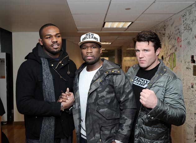 Jon Jones and Chael Sonnen with Fifty Cent, obviously. (Getty)