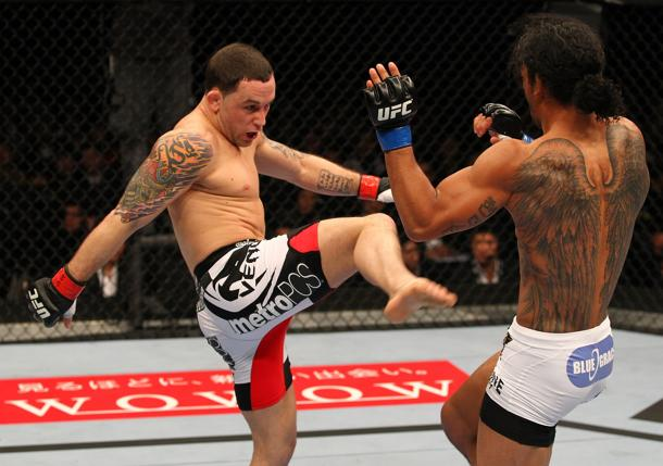 Frankie Edgar kicks Ben Henderson. (Getty)