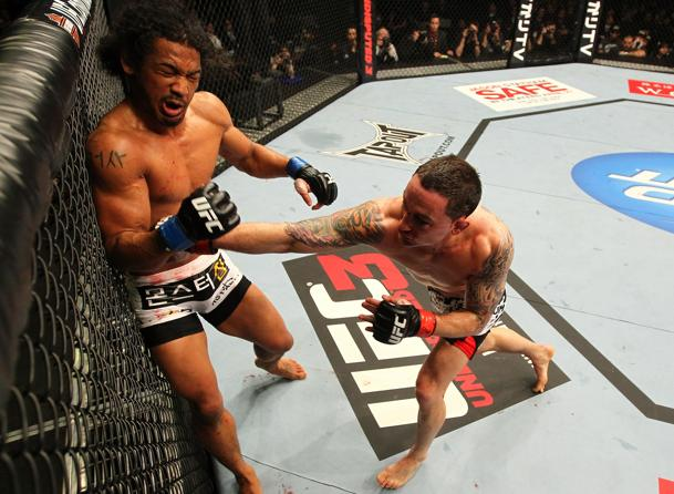 Frankie Edgar making his mark on Ben Henderson. (Getty)