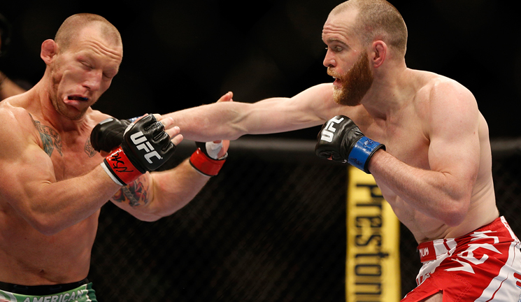 T.J. Grant (R) connects with a right hand on Gray Maynard at UFC 160 (Getty Images)