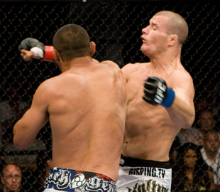 Dan Henderson (L) KOs Michael Bisping with the 'H-Bomb' at UFC 100 (Getty)
