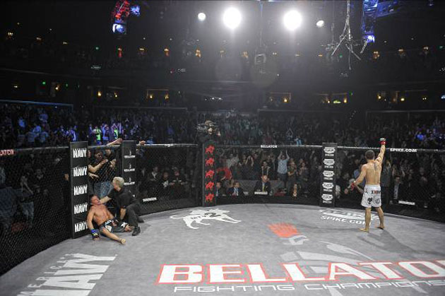 Pat Curran celebrates while Joe Warren is tended to. (Bellator)