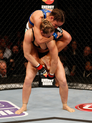 Ronda Rousey fights off a choke by Liz Carmouche (Getty)