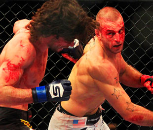 A bloody Saffiedine throws a big right (Las Vegas Sun)