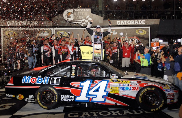 Tony Stewart celebrates his third win of 2012 and his fourth in the Coke Zero 400. (Getty)