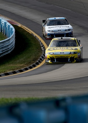Marcos Ambrose (F) and Aric Almirola are swapping crew chiefs. (Getty)
