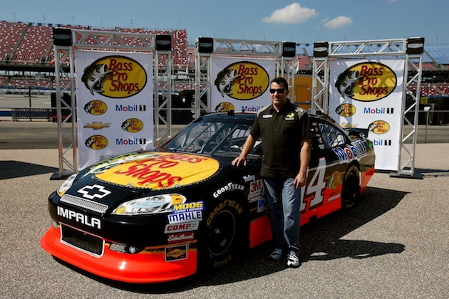 Tony Stewart and his new ride for 2013 adorned on a 2012 car. (Getty)