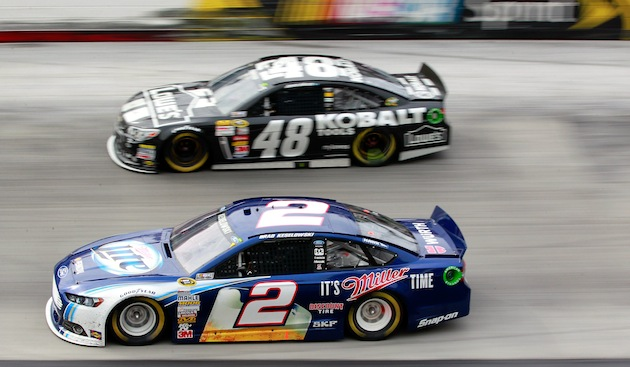 Brad Keselowski and Jimmie Johnson: side by side on the track and in the garage. (Getty)