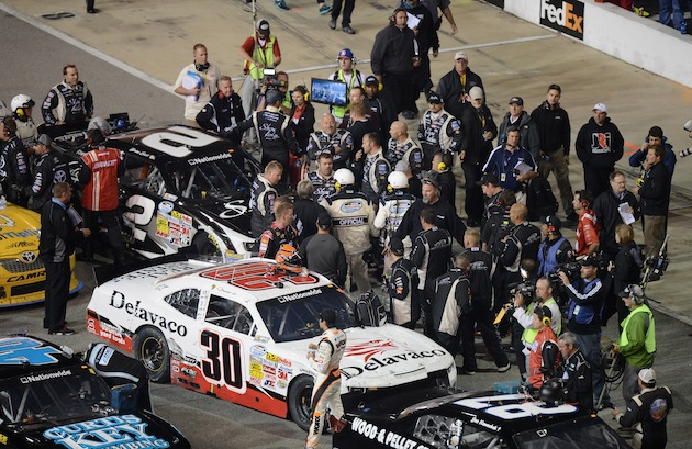 What happened on pit road between Nelson Piquet Jr. and Brian Scott. (Getty)