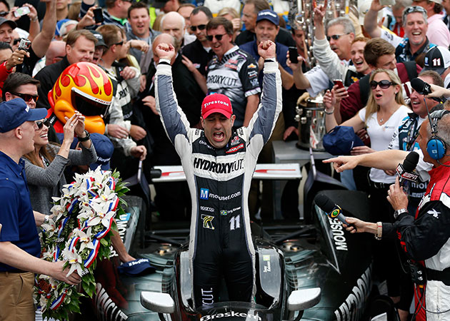 Tony Kanaan celebrates winning the Indianapolis 500. (Getty Images)