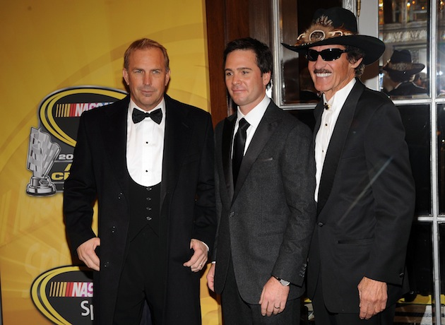 The best driver in this photo? Obviously Kevin Costner. (Getty)