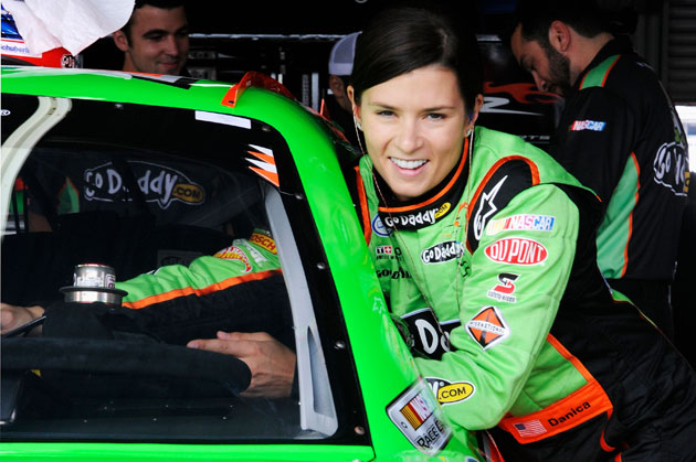 Danica Patrick is all smiles, like it or not. (Getty Images)