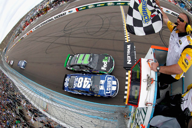 Denny Hamlin (11) and Jimmie Johnson (48) race to the finish in Phoenix. (Getty Images)