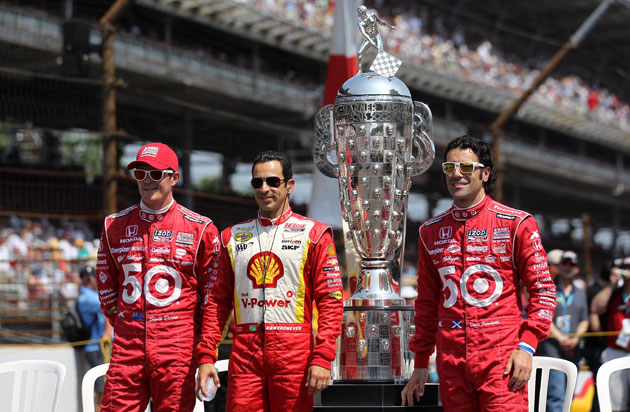 Scott Dixon, Helio Castroneves, demonic trophy, Dario Franchitti. (Getty Images)
