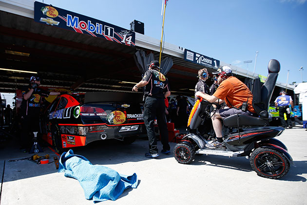 Tony Stewart watches the goings-on from the scooter. (Getty Images)