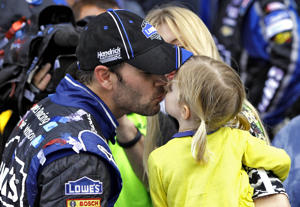 Jimmie Johnson celebrates with his daughter Evie after winning the Daytona 500. (AP)