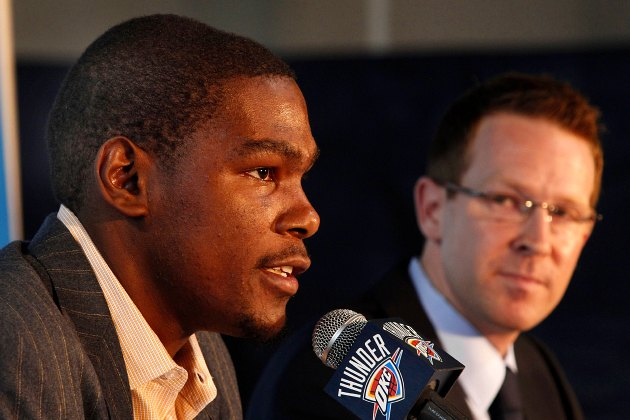 Sam Presti eyes Kevin Durant at the 2010 announcement of his contract extension (Layne Murdoch/ Getty).