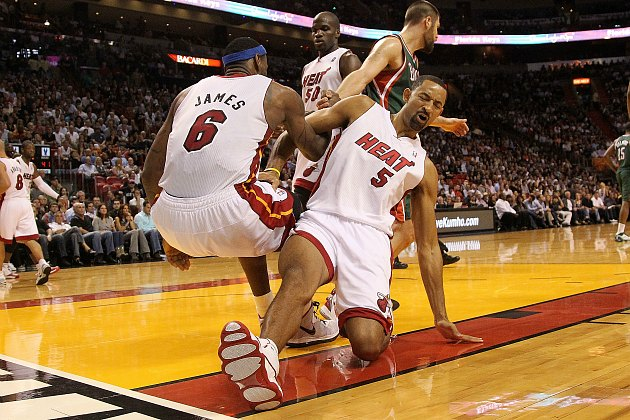 Juwan Howard tries to help LeBron James, slips, falls, buys Hoveround (Mike Ehrmann/ Getty).